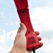 Man holding a red phone — Stock Photo
