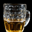 Half-full glass of beer — Stok fotoğraf