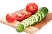 Fresh red tomato and cucumber — Stock Photo