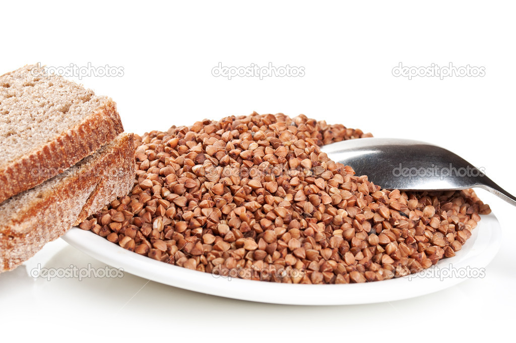 Buckwheat and bread on plate isolated on a white background — Stock Photo #6836085