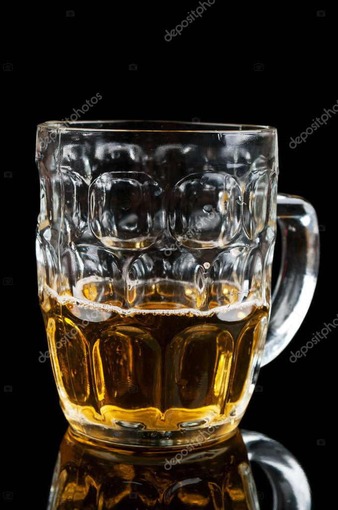 Half-full glass of beer isolated on a black background — Stock Photo #6837687