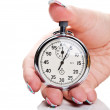 Woman holding a stopwatch — Stock Photo