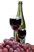 Glass of wine and red grapes — Stock Photo