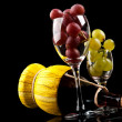 Grapes and a bottle of wine - Stock Photo