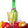 Christmas balls and bottle of champagne — Stock Photo