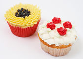 Two cupcakes with decorative techniques — Stock Photo