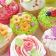 Stock Photo: Vanillcupcakes with various decorations