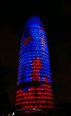 Lighting of the tower Agbar of Barcelona. — Stock Photo