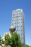 Tower with ball sculpture. — Stock Photo