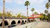 Park with red drawbridge — Stock Photo