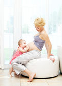 Pregnant mother and baby girl — Stock Photo