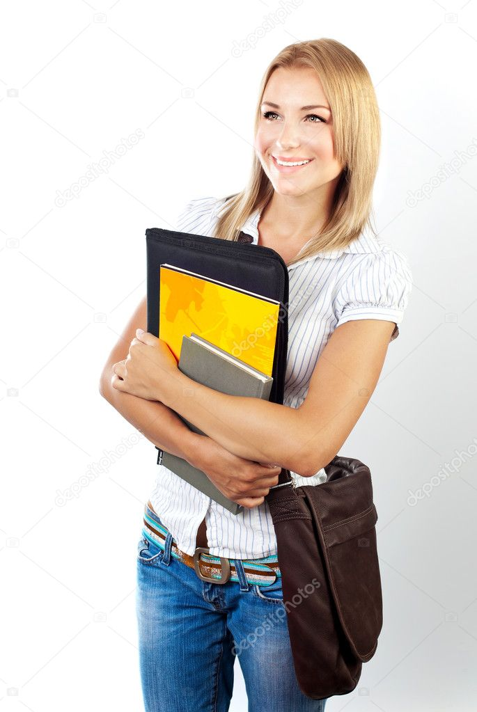 Happy young pretty student girl holding books, back to school concept — Stock Photo #6771422