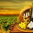 Стоковое фото: Wine and cheese romantic dinner outdoor