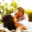 Happy couple kissing - Stock Photo