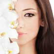 Closeup on beautiful face with flowers — Stock Photo