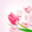 Spa candle with pink tulip flowers — Stock Photo