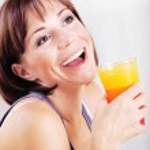 Happy healthy female drinking juice — Stock Photo
