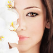 Closeup on beautiful face with flowers — Stock Photo #7107746