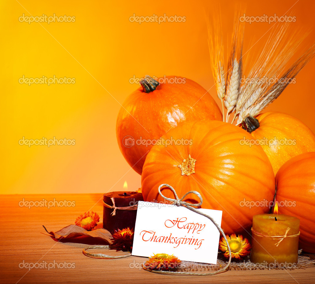 Thanksgiving holiday, pumpkin border still life decoration with candles and wheat over yellow studio light background, greeting card with text space, harvest co  Zdjcie stockowe #7107790