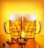 Beer and nuts — Stock Photo