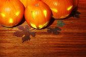 Glowing Halloween pumpkins border — Stock Photo