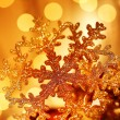 Golden snowflake Christmas tree decorations — Stock Photo