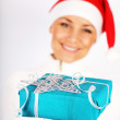 Stock Photo: Happy Santa girl with gift