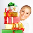 Happy girl with many gifts — Stock Photo
