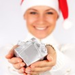 Happy Santa girl with a gift — Stock Photo