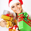 Stock Photo: Happy Santa girl with gifts