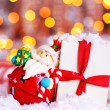 Holiday background with cute Santa decoration - Stock Photo