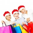 Happy Santa boys with gifts — Stock Photo