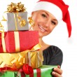 Santa girl with gifts — Stock Photo #7789913