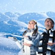 Happy couple playing outdoor at winter mountains — Stock Photo