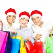Happy Santa boys with gifts — Stock Photo #7790734