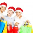 Stock Photo: Happy Santa boys with gifts