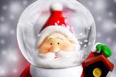 Santa Claus in the snow globe — Stock Photo