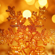 Golden snowflake Christmas tree decoration — Stock Photo