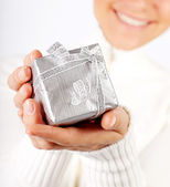 Happy female with a gift — Stock Photo