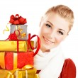 Beautiful female holding gifts — Stock Photo