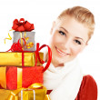 Beautiful female holding gifts — Stock Photo #7911638