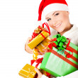 Happy Santa girl holding Christmas gifts — Stockfoto
