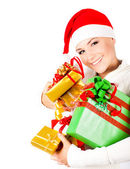 Happy Santa girl holding Christmas gifts — Stock Photo