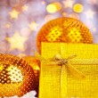 Golden Christmas gift with baubles decorations — Stock Photo #7939492