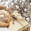 Silver Christmas gift with baubles decorations — Stock Photo #7939526