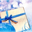 Golden blue Christmas gift with baubles decorations — Foto de Stock