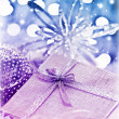 Purple blue Christmas gift with baubles decorations — Stock Photo