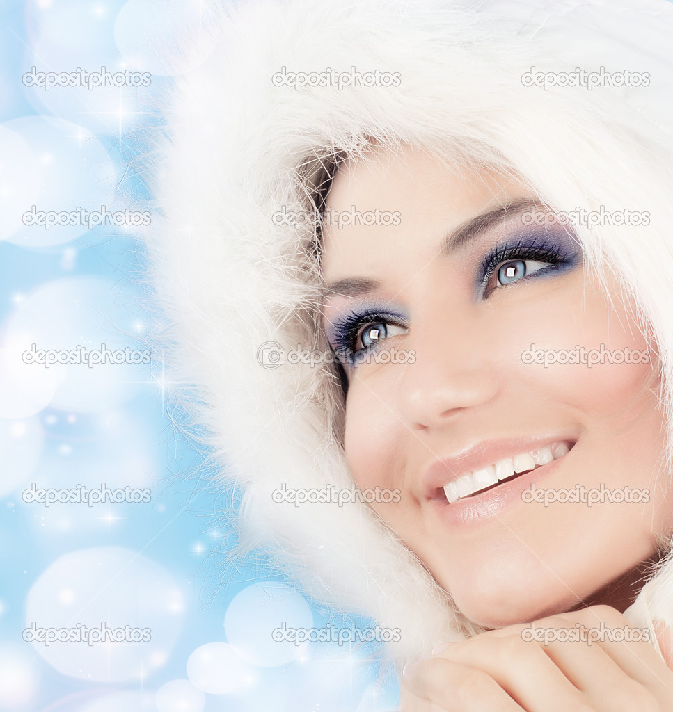 Snow queen, beautiful woman in Christmas style makeup, female portrait over blue holiday background with shiny glowing glitters and bokeh lights — Stock Photo #7939378