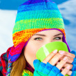 Beautiful girl drinking hot chocolate outdoor in winter — Stock Photo #7940488