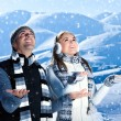 Happy couple playing outdoor at winter mountains - Stock Photo